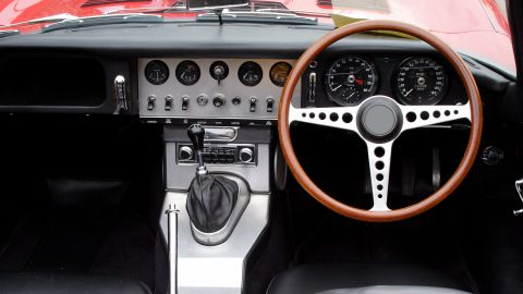 Vintage car interior with wooden steering wheel