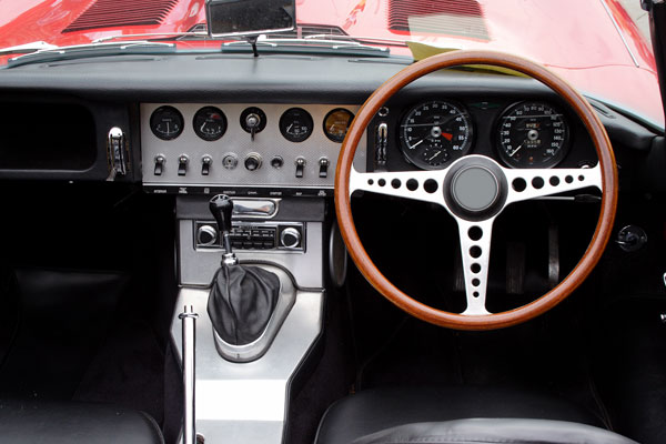 Classic dashboard with wooden steering wheel