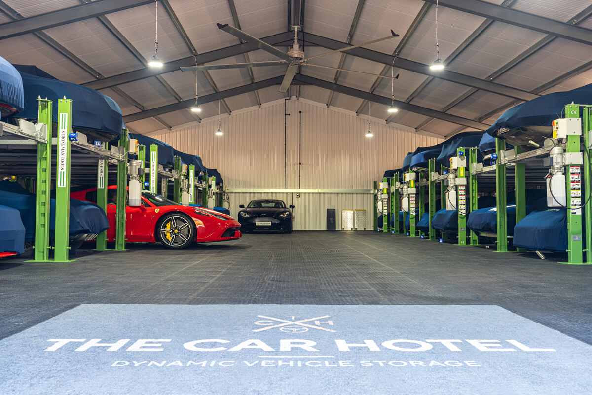 Ferrari 458 Speciale Aperta in the barn at The Car Hotel - with Aston Martin in the background